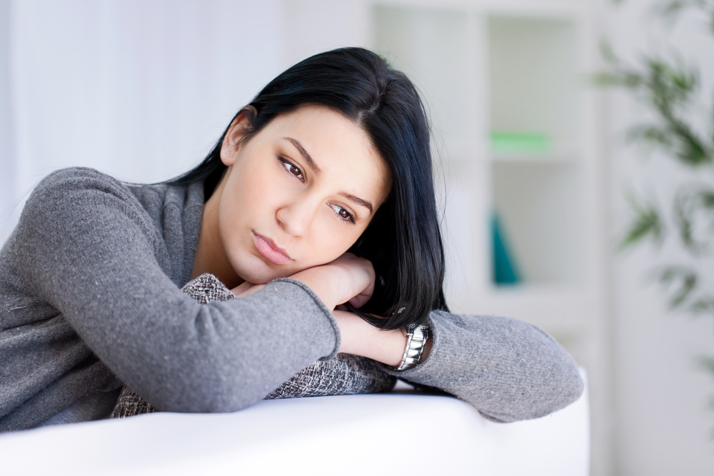 Stressed woman thinking